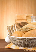 Fresh bread on wood background — Stock Photo