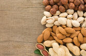 Set of nuts fruit and on wood — Stock Photo