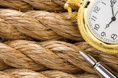 Watch with pen on ship ropes — Stock Photo
