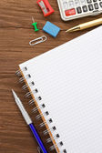 School supplies and paper notepad — Stock Photo