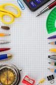 School supplies on checked paper — Zdjęcie stockowe