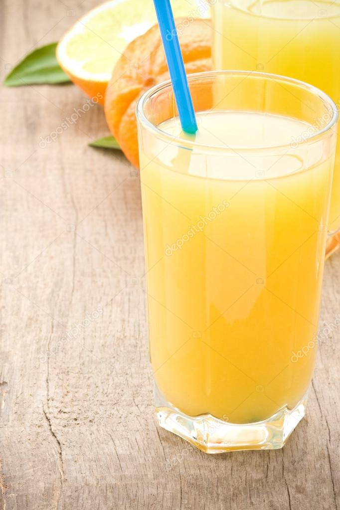 Fresh fruits orange juice in glass on wood table background  Stock Photo #12447888