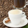Cup of coffee and beans - Stock Photo