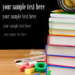 Stock Photo: Back to school supplies isolated on black
