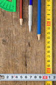 Pencil and tape measure on wood — Stock Photo