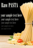 Raw pasta and food ingredient isolated on black — Stock Photo