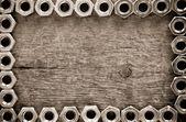 Metal nuts tool on wood — Stock Photo