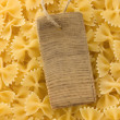 Raw pasta and price tag - Stock Photo