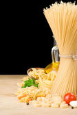 Raw pasta and food vegetable isolated at black — Stock Photo