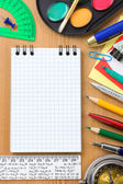 Back to school and office supplies on wood — Stock Photo