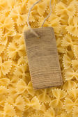 Raw pasta and price tag — Foto Stock