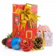 Christmas gift box with balls on white — Stock Photo #12777621