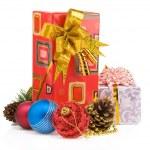Christmas gift box with balls on white — Stock Photo