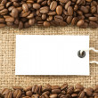 Coffee beans and paper price tag on sack — Foto de Stock