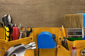 Tools in construction belt on wood — Stock Photo
