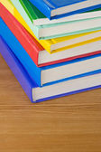 Pile of books at wood background — Stock Photo