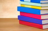 Pile of books on wood — Stock Photo
