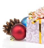 Christmas gift box with balls isolated on white — Stock Photo