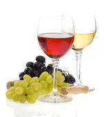 Wine in glass and grape fruit isolated on white — Stock Photo