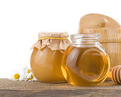 Honey in jar isolated on white — Stock Photo