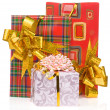 Gift box with gold ribbon isolated on white — Stock Photo