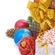 Christmas gift box with balls on white - Stock Photo