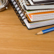 Stock Photo: Notebook and pens on wood background