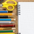 School accessories on checked notebook — Stockfoto