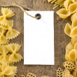 Pasta and price tag on wood - Stock Photo