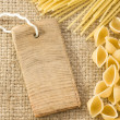 Pasta and price tag on sack burlap - Stock Photo