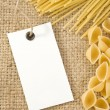 Raw pasta on sack burlap - Stock Photo
