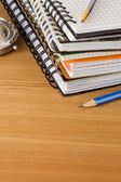 Notebook and pens on wood background — Stock Photo