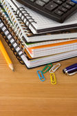 Notebook and school accessories — Stock Photo