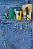 Tools and instruments in jeans pocket — Stock Photo