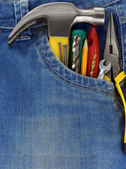 Set of tools and instruments in jeans — Stock Photo