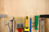 Tools on wood background board — Stock Photo