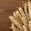 Stock Photo: Ears of wheat on wood