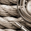 Compass with pen on ship ropes — Stock Photo #13466595