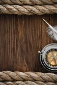 Ship ropes and compass at wood — Stock Photo