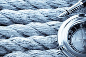 Compass with pen on ship ropes — Stock Photo