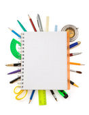 School supplies and checked notebook on white — Stock Photo
