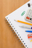 School supplies on paper notepad — Stock Photo