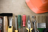 Kit of construction tools on wood — Stock Photo