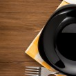 Plate, knife and fork on wood — Stock Photo #14162452