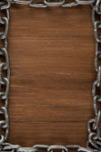 Metal chain on wood — Stock Photo