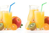 Ripe fruits and juice in glass — Stock Photo