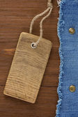 Blue jean on wood texture — 图库照片