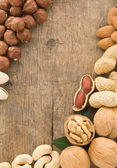 Variety of nuts on wood — Stock Photo