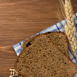 Rye bread and ears of wheat - Stock Photo