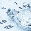 Ink pen and watch on calendar — Stock Photo #16272401